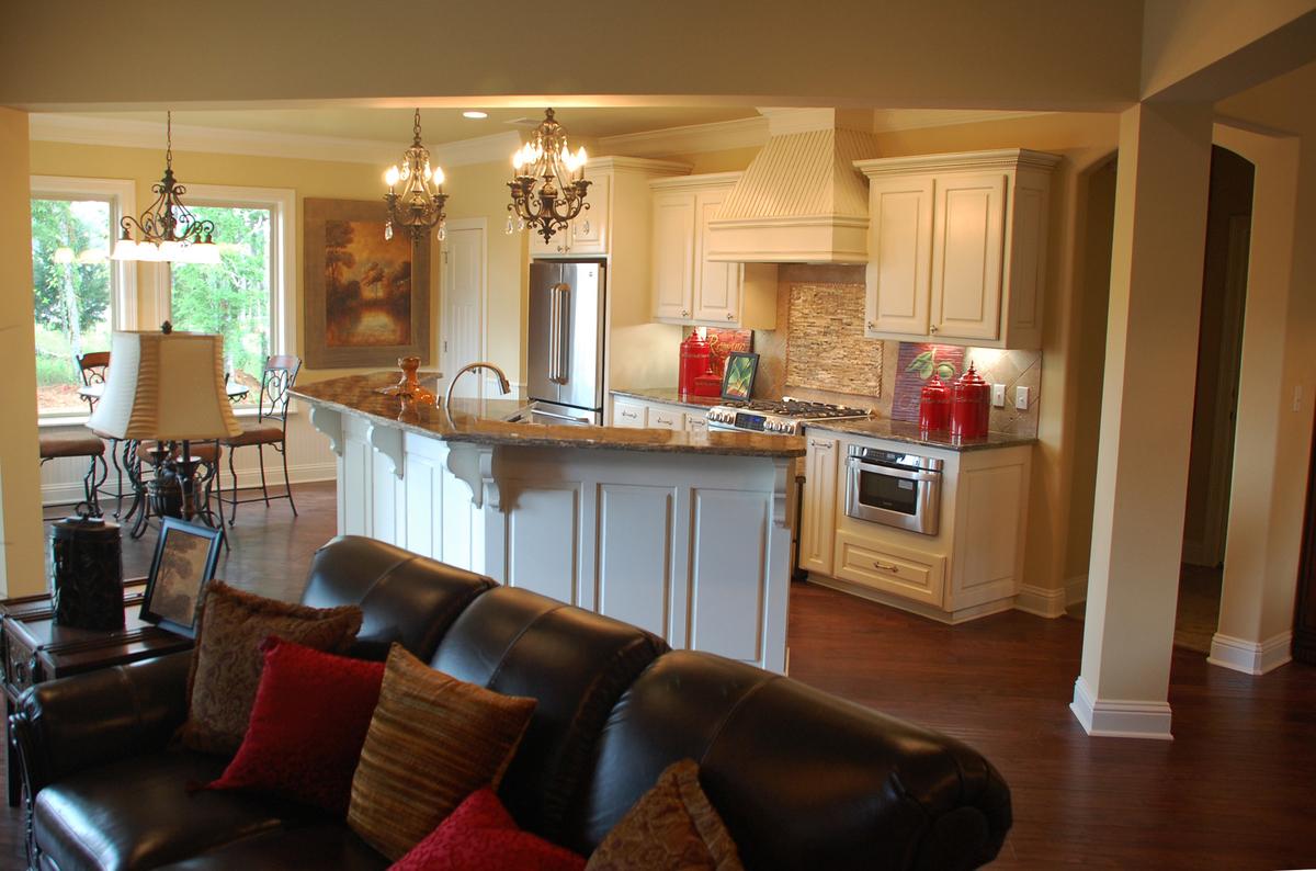 Open kitchen, great room, breakfast room, and dining room in The Sorvino Floor Plan 1222