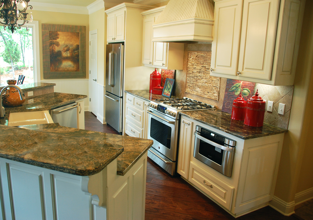 Counter-depth refrigerator in the small, open concept Kitchen of The Sorvino - House Plan Number 1222