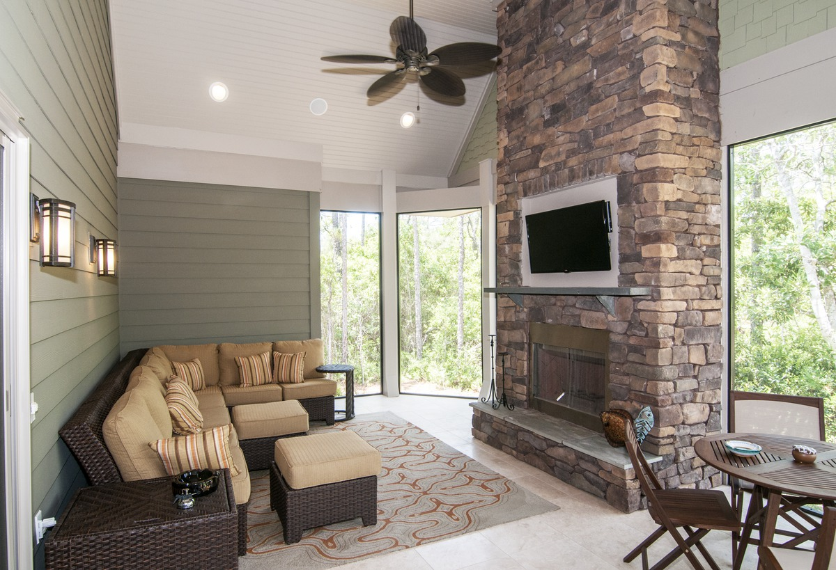 Great Outdoors. Screened Porch with lounge area of The Sagecrest Plan #1226